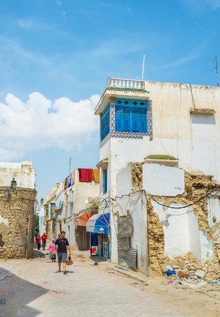 september 2: TUNIS, TUNISIA - SEPTEMBER 2, 2015: All the houses of Medina are very old and sometimes some of them become the ruins, on September 2 in Tunis.
