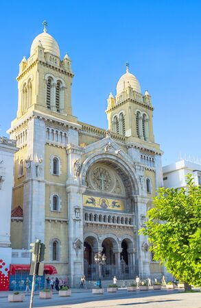 independance: TUNIS, TUNISIA - AUGUST 30, 2015: The catholic Cathedral of St Vincent de Paul located at the Place de lIndépendence in the Ville Nouvelle, on August 30 in Tunis.