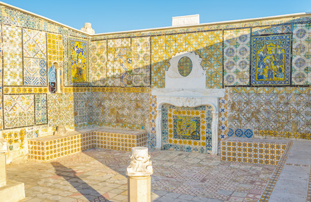 The walls with the glazed tiles surves as the summer house on the roof of old mansion in Medina, Tunis, Tunisia.