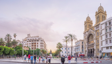 independance: TUNIS, TUNISIA - AUGUST 30, 2015: The Independance Square with it seuropean architecture is one of the important centers of the city life, on August 30 in Tunis.