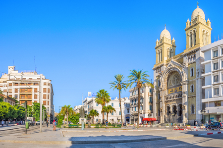 independance: TUNIS, TUNISIA - AUGUST 30, 2015: The catholic Cathedral of St Vincent de Paul is the famous tourist landmark, located at the Place de lIndépendence in the Ville Nouvelle, on August 30 in Tunis.