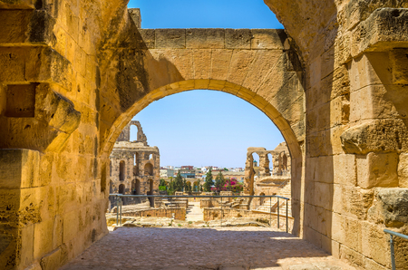 amphitheatre: The view on the roman ruins of amphitheatre through the arch of its hall, El Jem, Tunisia. Stock Photo