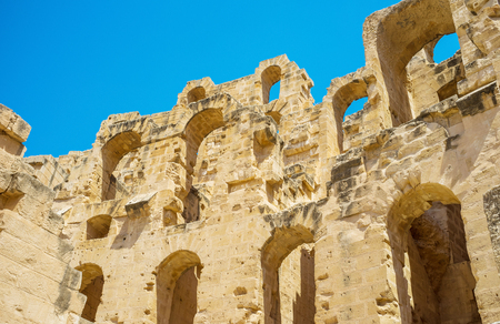 lace like: EL JEM, TUNISIA - SEPTEMBER 1, 2015: The walls of the Roman amphitheatre with the numerous arches looks like lace, on September 1, in El Jem. Editorial
