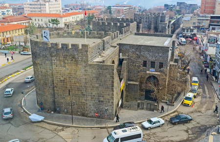 rampart: DIYARBAKIR, TURKEY - JANUARY 15, 2015: The old town is surrounded by the black basalt rampart with numerous towers, on January 15 in Diyarbakır.