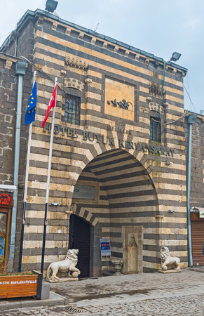 guides: DIYARBAKIR, TURKEY - JANUARY 15, 2015: The  gate to the Deliller Hani (Guides Khan), the medieval guest house for travelers and pilgrims, on January 15 in Diyarbakir.