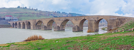 Panorama of the Dicle Bridge over the Tigris River in the rainy day, Diyarbakir, Turkey. Stock Photo