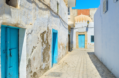 kairouan: Many houses in old Kairouan have blue doors, according to the local tradition, Tunisia. Stock Photo