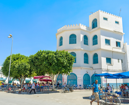 kairouan: KAIROUAN, TUNISIA - AUGUST 30, 2015: The old town is full of the outdoor cafes and coffee houses where locals spend their middays, on August 30 in Kairouan.