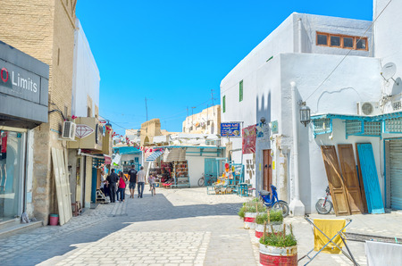 best way: KAIROUAN, TUNISIA - AUGUST 30, 2015: The best way to discover the old town is to get lost in the maze of its medieval streets, on August 30 in Kairouan. Editorial