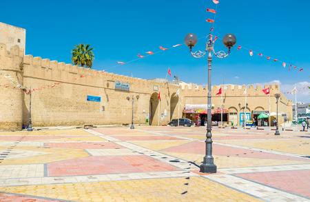 kairouan: KAIROUAN, TUNISIA - AUGUST 30, 2015: The gates to Medina and the old ramparts located at the square of Martyrs, on August 30 in Kairouan.