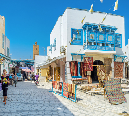 kairouan: KAIROUAN, TUNISIA - AUGUST 30, 2015: The city is the centre of rug manufacturing in Tunisia, so here locates the large carpet market, on August 30 in Kairouan. Editorial
