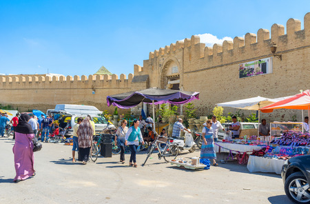 kairouan: KAIROUAN, TUNISIA - AUGUST 30, 2015: The fortress wall is well preserved and surrounds the historic district of Medina, on August 30 in Kairouan.