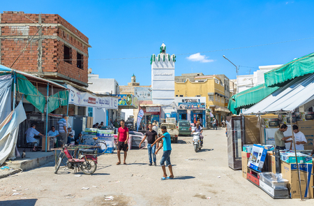 kairouan: KAIROUAN, TUNISIA - AUGUST 30, 2015: The arabic market is crowded and noisy place with the wide range of goods on each taste, on August 30 in Kairouan.
