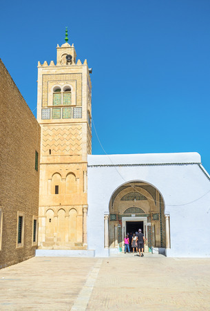 kairouan: KAIROUAN, TUNISIA - AUGUST 30, 2015: The beautiful minaret of Zaouia Sidi Sahab (Barbers mosque) and its main entrance, on August 30 in Kairouan. Editorial