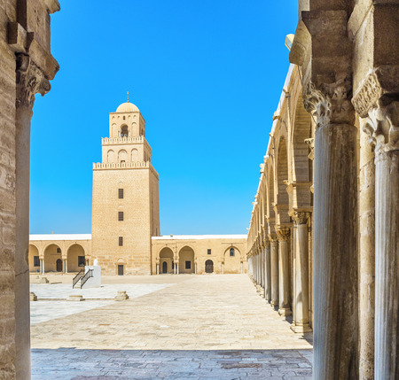 kairouan: KAIROUAN, TUNISIA - AUGUST 30, 2015: The view on the minaret of the Great Mosque from its courtyard, on August 30 in Kairouan. Editorial