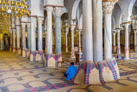 kairouan: KAIROUAN, TUNISIA - AUGUST 30, 2015: The old prayer hall of the Grand Mosque with the rows of ancient columns made of different meterials, on August 30 in Kairouan.