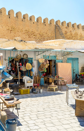 kairouan: KAIROUAN, TUNISIA - AUGUST 30, 2015: The large market along the citadel walls is the important part of every arabic town, on August 30 in Kairouan.