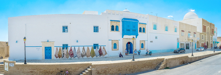 kairouan: KAIROUAN, TUNISIA - AUGUST 30, 2015: The historic neighborhood next to the Grand Mosque is occupied by numerous rug stores and workshops, on August 30 in Kairouan.