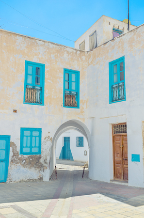 kairouan: All the houses in old neighborhoods are white and the windows and doors offen painted in blue color, according to the ancient tradition, Kairouan, Tunisia.
