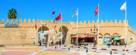 kairouan: KAIROUAN, TUNISIA - AUGUST 30, 2015: The square next to the town gates decorated with national flags, on August 30 in Kairouan.