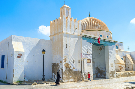 kairouan: KAIROUAN, TUNISIA - AUGUST 30, 2015: The beautiful mosque with the large ribbing dome, that is a traditional arabic detail, on August 30 in Kairouan.