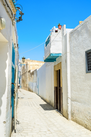 kairouan: The town boasts well preserved arabic Medina with maze of the narrow streets and tiny white traditional houses, Kairouan, Tunisia. Stock Photo