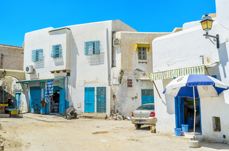 kairouan: KAIROUAN, TUNISIA - AUGUST 30, 2015: The small neighborhood somewhere in Medina with a small cafe and local grocery, on August 30 in Kairouan.