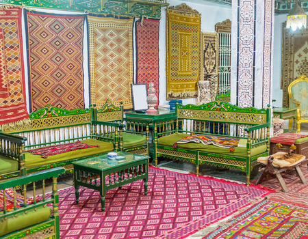 kairouan: KAIROUAN, TUNISIA - AUGUST 30, 2015: The interiors of Government mansion decorated with many traditional rugs and the old carpet workshop located tere, on August 30 in Kairouan.