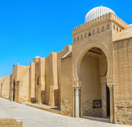 rampart: The outer wall of the Grand Mosque is the huge medieval rampart with gates in arabic style with beautiful domes, Kairouan, Tunisia.