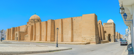 kairouan: The Grand Mosque of Kairouan is the perfect example of medieval defensive citadel with massive ramparts and huge gates, Tunisia.