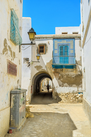 kairouan: The old house across the street has the narrow passage, Kairouan, Tunisia. Stock Photo