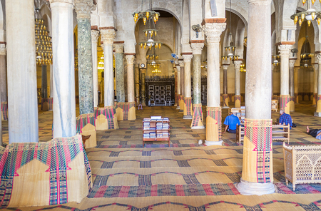 prayer rug: KAIROUAN, TUNISIA - AUGUST 30, 2015: The interior of the Grand Mosque with many raws of different stone pillars, on August 30 in Kairouan.