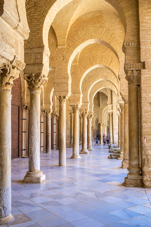 kairouan: KAIROUAN, TUNISIA - AUGUST 30, 2015: Its easy to get lost in maze of columns in covered courtyard of Grand Mosque, on August 30 in Kairouan. Editorial
