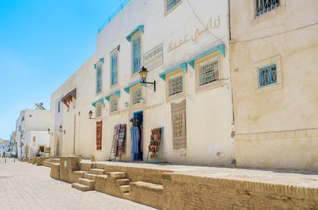 kairouan: KAIROUAN, TUNISIA - AUGUST 30, 2015: Kairouan is the centre of rug manufacturing, so there are a lot of rug steres there, on August 30 in Kairouan.