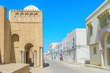 kairouan: KAIROUAN, TUNISIA - AUGUST 30, 2015: THe scenic side gates of the Grand Mosque on the narrow street with the medieval mansions, on August 30 in Kairouan. Editorial