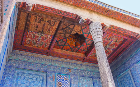 harem: KHIVA, UZBEKISTAN, MAY 3, 2015: The ceiling in harem courtyard of Tosh Hovli (or Tash Hauli) Palace decorated with colorful carved wooden patterns, on May 3 in Khiva. Editorial