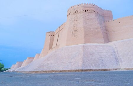 surrounds: The long fortress wall surrounds Itchan-Kala, the medieval town of Khiva, Uzbekistan.
