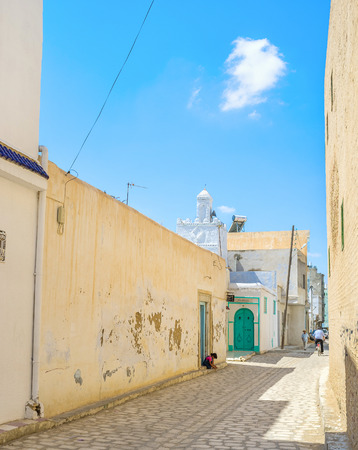 kairouan: KAIROUAN, TUNISIA - AUGUST 30, 2015: To walk in old Medina is the best way to discover arabic town, on August 30 in Kairouan.