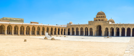 kairouan: The scenic courtyard of the Grand Mosque with the shady terrace and old sundial in the middle, Kairouan, Tunisia. Stock Photo