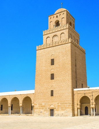kairouan: The high brick minaret of the Grand Mosque, Kairouan, Tunisia. Stock Photo