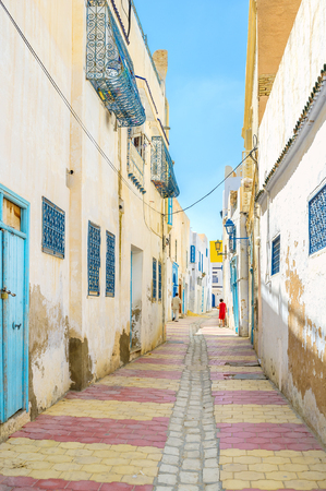 arabic architecture: The quiet streets of Medina are the best place to discover the old town and enjoy arabic architecture and lifestyle, Kairouan, Tunisia. Stock Photo