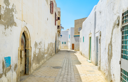 kairouan: Medina is the old residential district in arabic towns, here locate the small houses, local stalls and tiny mosques, Kairouan, Tunisia.