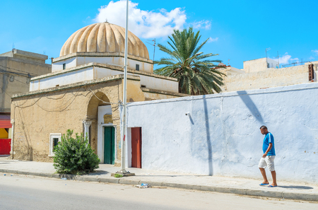 kairouan: KAIROUAN, TUNISIA - AUGUST 30, 2015: The small mosque with the ribbed dome in the old town, on August 30 in Kairouan.