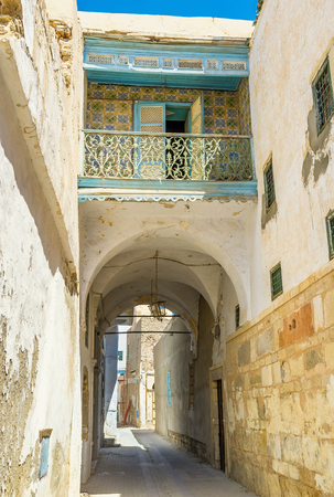 kairouan: KAIROUAN, TUNISIA - AUGUST 30, 2015: The small colorful balcony over the long passage in Medina, on August 30 in Kairouan.