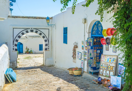 backstreet: SIDI BOU SAID, TUNISIA - AUGUST 31, 2015: The local souvenur shop situated in the scenic backstreet, on August 31 in Sidi Bou Said. Editorial