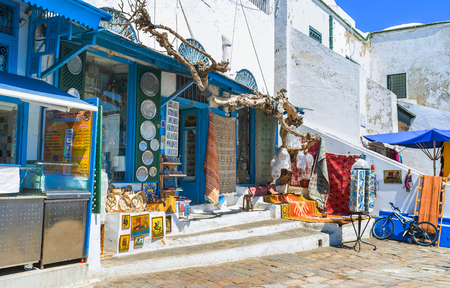 arabic architecture: SIDI BOU SAID, TUNISIA - AUGUST 31, 2015: Many tourists visit this village from Tunis, enjoying authentic arabic architecture, local cusine and hand made souvenirs, on August 31 in Sidi Bou Said.