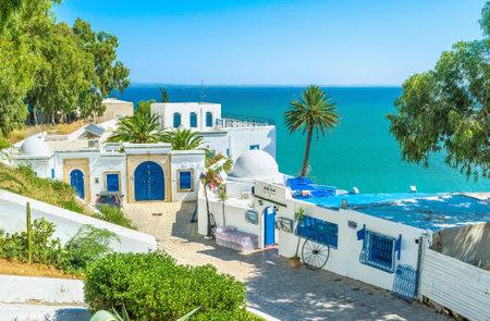 SIDI BOU SAID, TUNISIA - AUGUST 31, 2015: The village is the luxury Tunisian resort located on the mountain in Tunis suburb, on August 31 in Sidi Bou Said.