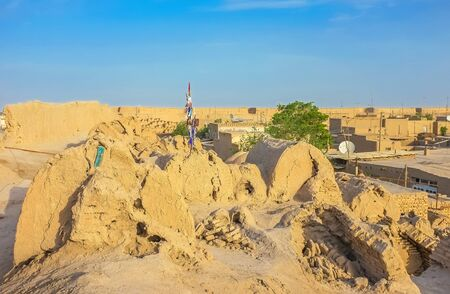 rampart: The medieval rampart and historic tombs on it were covered with clay, that was washed away by rain water, Khiva, Uzbekistan.