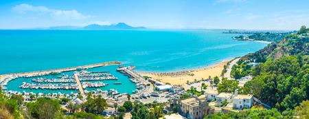 sidi bou said: The scenic coastline of Sidi Bou Said with the large haven, full of yachts, Tunisia.