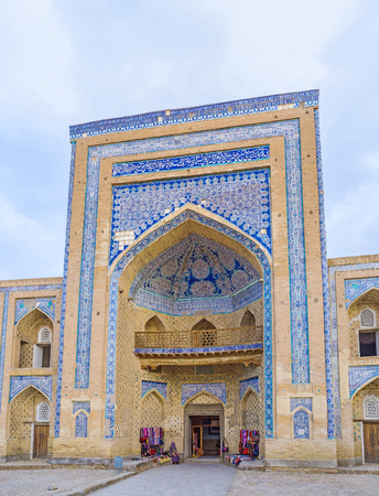 muhammad: The central portal of Muhammad Rahim-khan Madrasah decorated with blue glazed tiles with the white islamic patterns and hieroglyphs, Khiva, Uzbekistan.